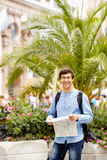 Tourist with map in hands Royalty Free Stock Photo