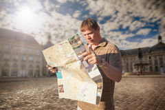Tourist with map. Tourist with man in Bordeaux city Stock Images