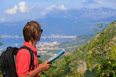 Tourist with map on mountains vacation stock images