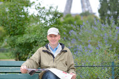 Tourist with a map in Paris Stock Photography