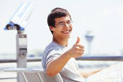 Tourist with map showing thumb up Stock Photo