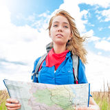 Tourist with map in summer field. Stock Photography
