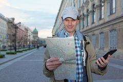Tourist with a map and a tablet in St. Petersburg, Russia Royalty Free Stock Images