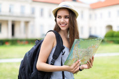 Tourist with Map. Young woman with tourist map royalty free stock photo