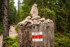 Tourist mark on a stump Stock Images