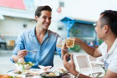 Tourist Men Cheers Toast Drink, Asian Mix Race royalty free stock photography