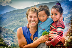 Tourist men with two little girls from Nepal Royalty Free Stock Photography