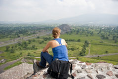 Tourist in Mexico. Tourist in Teotihuacan archaeological site (Mexico). The Pyramid of the Moon in background Stock Image