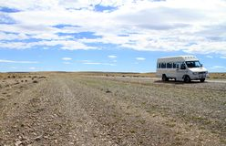 Minibus on Roadside. A tourist minibus parked on the side of a rural road in the wilds of Patagonia, South America Stock Photo