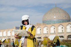Tourist model. A woman tourist looking into a map in Iran Stock Photo