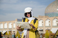 Tourist model. A woman tourist looking into a map in Iran Stock Photos