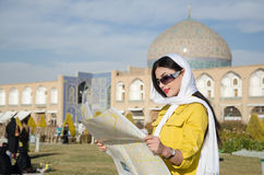 Tourist model. A woman tourist looking into a map in Iran Royalty Free Stock Photo