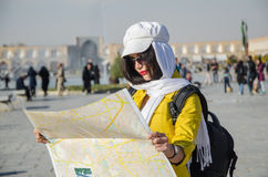 Tourist model. A woman tourist looking into a map in Iran Royalty Free Stock Photography
