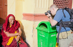 Tourist and monk Royalty Free Stock Photos
