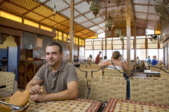 Tourist in Morocco eating bread Stock Images