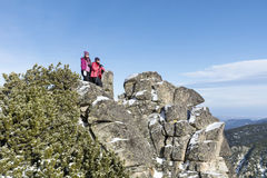 Tourist mother and  daughter climbing in the winter mountain Royalty Free Stock Images