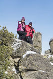 Tourist mother and  daughter climbing in the winter mountain Royalty Free Stock Photo