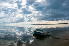 Tourist motor boat on beach of Gili Air in Lombok with clouds re Stock Photography