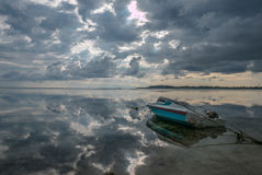 Tourist motor boat on beach of Gili Air in Lombok with clouds re Royalty Free Stock Images