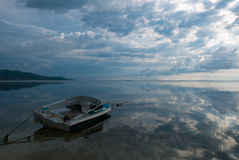 Tourist motor boat on beach of Gili Air in Lombok with clouds re Royalty Free Stock Photo