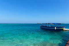 Tourist motorboat near del Rosario Islands, Colombia. Royalty Free Stock Images