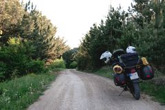 Tourist motorcycle with side bags. enduro advetnture, space for text, summer day. Adventure expedition, explore, dirt road, stock photos