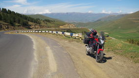 Tourist Motorcycle Stands Along a Serpentine Road in the Mountains of Armenia. Moto travel. stock video
