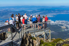 tourist on Mount Wellington looking at Hobart city below Stock Images