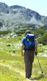 Tourist on mountain Royalty Free Stock Photography