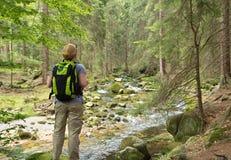Tourist at the mountain creek Royalty Free Stock Photo