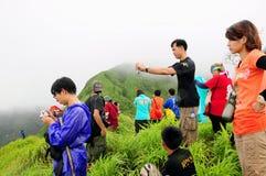 Tourist on mountain Royalty Free Stock Photo