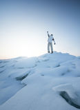 Tourist on mountain peak Stock Photo