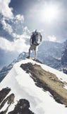 Tourist on mountain peak Royalty Free Stock Photos