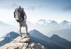 Tourist on mountain peak Royalty Free Stock Image