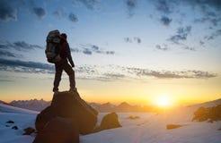 Tourist on mountain peak Stock Image