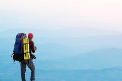 Tourist on the mountain top. Stock Photo