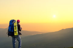 Tourist on the mountain top. Royalty Free Stock Image