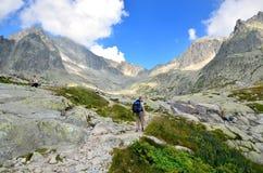 Tourist on the mountain trail. Stock Image