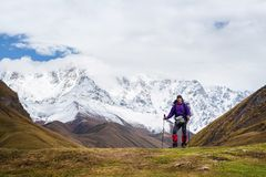 Tourist in a mountain trekking near the top of Shkhara, Svaneti stock images