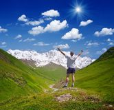 Tourist in the mountains of the Caucasus Stock Photo