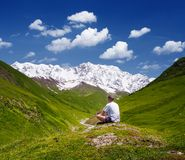 Tourist in the mountains of the Caucasus Royalty Free Stock Image