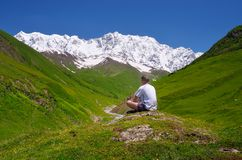 Tourist in the mountains of the Caucasus Stock Images