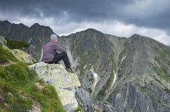 Tourist in mountains Stock Photos