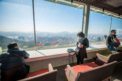 Tourist at N Seoul Tower lounge. Royalty Free Stock Images