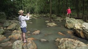 Tourist at Na Muang Waterfall on Koh Samui in Thailand stock footage video stock footage