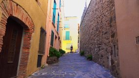 Tourist on the narrow streets of the European city of Colliour