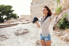 The tourist near the Acropolis of Athens, Greece Royalty Free Stock Photos