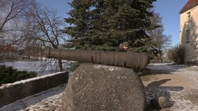 Tourist near antique canon in the medieval castle stock video footage