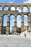 Tourist near Aqueduct of Segovia, Spain Stock Photography