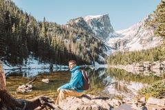Tourist near Dream Lake in Colorado. Tourist near Dream Lake at autumn in Rocky Mountain National Park. Colorado, USA Stock Image